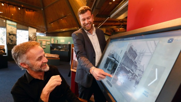 South Canterbury Museum director Philip Howe, left, watches Yellow Design creative director Tony Zwies reveal an historic view of Timaru's Church Street on the museum's new touch-screen photographic display.