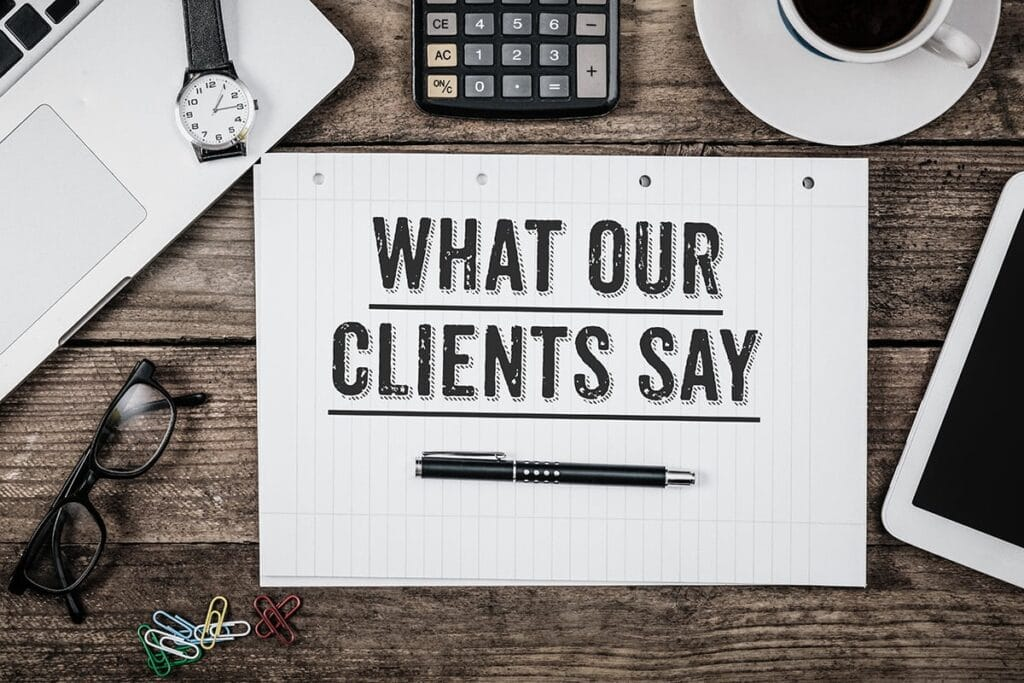 What our clients say as text imposed on some note pad.